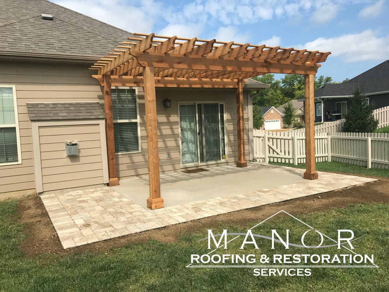 Wood pergola by Manor Roofing and Restoration Services